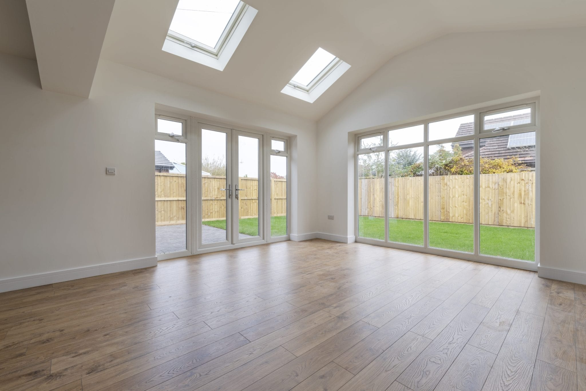 large living space with french doors and full length glazing